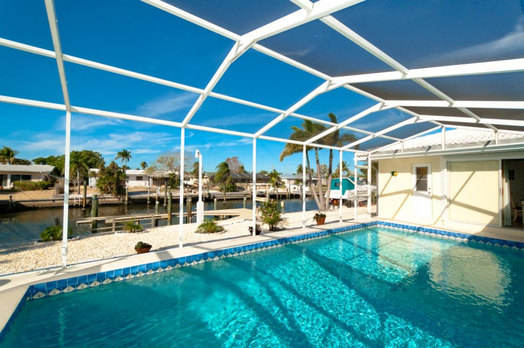 Pool and canal view of Anna Maria rental