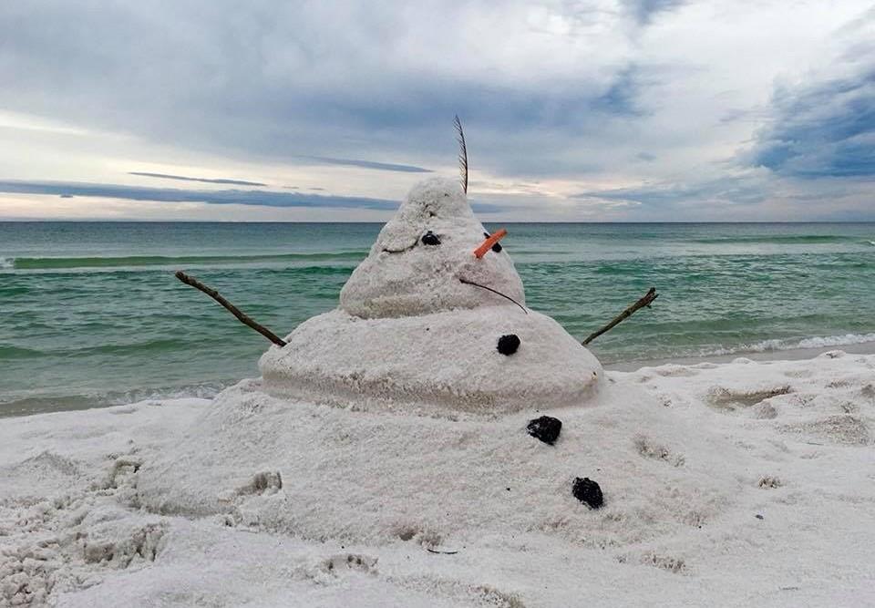 Sand snowman on Anna Maria Island beach