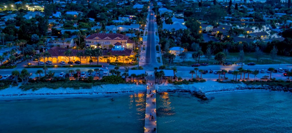 Aerial of AMI and pier at night